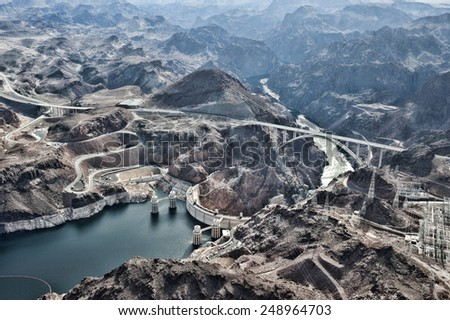 A view of the Hoover Dam from a helicopter. - stock photo