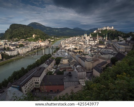 A view of the houses standing round the floating river Salzach in Salzburg, 2015 - stock photo