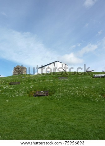 A view of the lifeguards house, next to fort ruins in Tenby in Wales. - stock photo