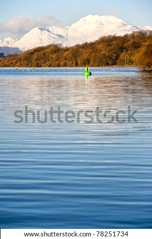 A view of the majestic and impressive ben lomond from across loch lomond near the scottish town of balloch. - stock photo