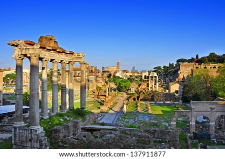a view of the Roman Forum in Rome, Italy, with the Coliseum in the background - stock photo