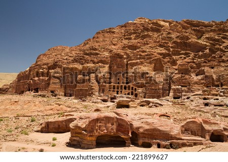 A view of the Royal Tombs and other ruins in Petra, Jordan. - stock photo