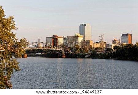 A view of the skyline of Little Rock, Arkansas at sunset. - stock photo