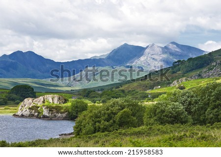 A view of the Snowdonia mountain range from beside the Llynnau Mymbyr lakes in the Dyffryn Mymbyr valley near Capel Curig, Conwy, Wales. - stock photo