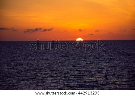 A view of the sun setting as seen from a cruise ship in the North Atlantic. - stock photo