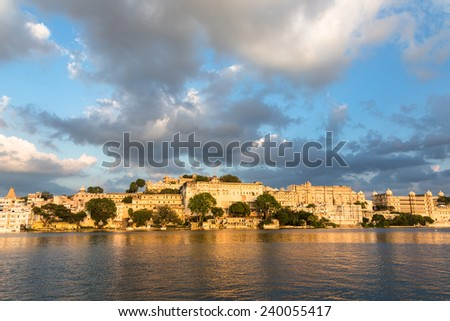 A view of Udaipur city Palace across Pichola lake in Udaipur, Rajasthan, India - stock photo
