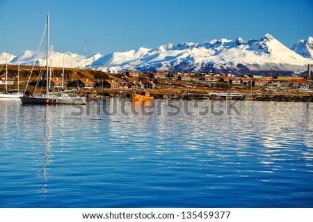 A view of Ushuaia and mountains seen from the Beagle Channel - stock photo