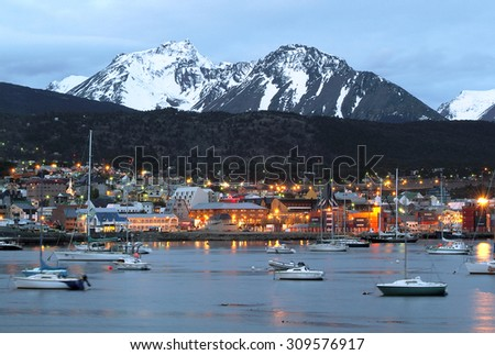 A view of Ushuaia, Tierra del Fuego. Boats line the harbor - stock photo