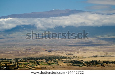 A view of Waimea and the observatories atop Mauna Kea. - stock photo