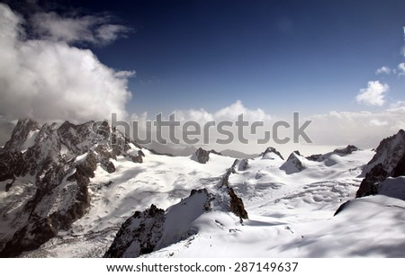 A view on Mont Blanc mountain range from top of Aiguille du Midi peak (3842m) - stock photo