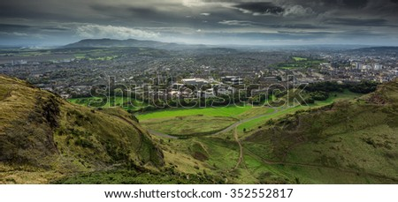 A view over Edinburgh from Arthur's seat in Holyrood park, Scotland - stock photo