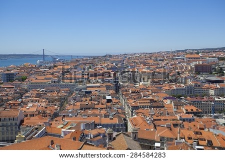 A view over the red rooftops of Lisbon city, the capital city of Portugal from the Castelo de Sao Jorge. - stock photo