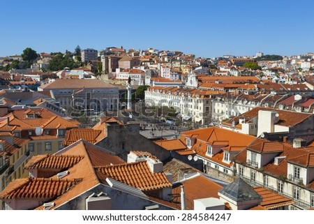 A view over the red rooftops of Lisbon city, the capital city of Portugal from the heights of the Funicular Elevador de Santa Justa. - stock photo