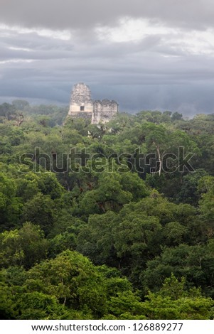 A view over the ruined Mayan city of Tikal in modern day Guatemala - stock photo