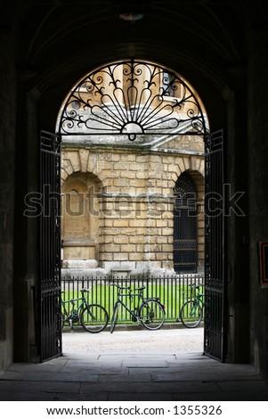 A view through an iron gate to a Georgian building - stock photo