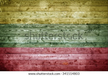 A vignetted background image of the flag of Lithuania painted onto wooden boards of a wall or floor. - stock photo