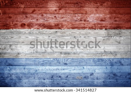 A vignetted background image of the flag of Luxembourg painted onto wooden boards of a wall or floor. - stock photo