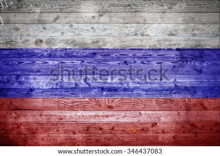 A vignetted background image of the flag of Russian Federation onto wooden boards of a wall or floor. - stock photo