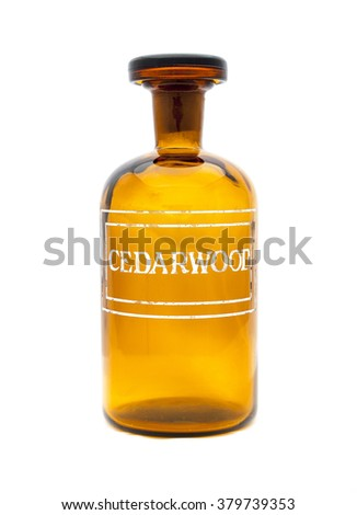 a vintage apothecary jar with cedarwood etched on front - stock photo