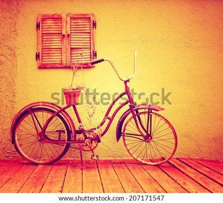 a vintage bike with retro shutters toned with a warm instagram filter - stock photo