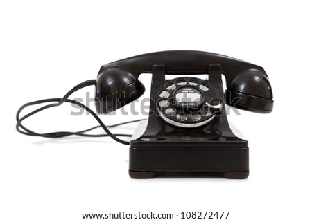 A vintage, black 1940's telephone on a white background - stock photo