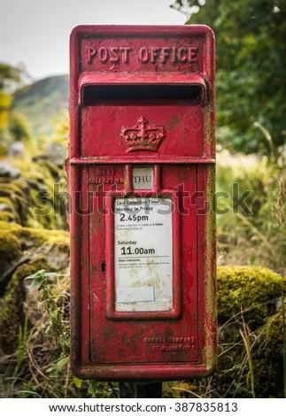 A Vintage British Village Post Or Mail Box - stock photo