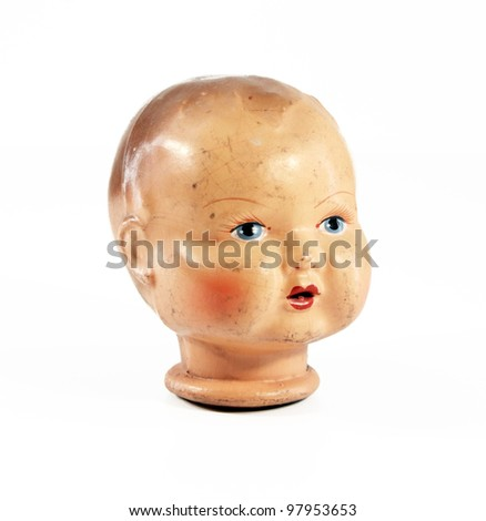 a vintage ceramic doll head, isolated on a white background - stock photo