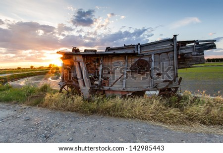 A vintage combine harvester in Northern Italy - stock photo