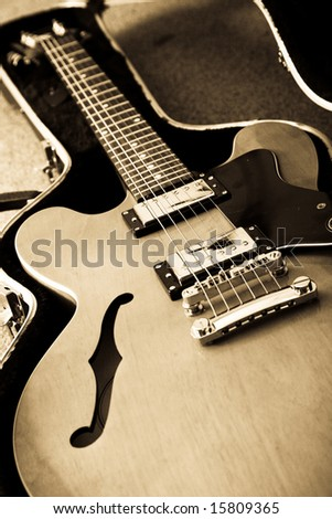 A vintage electro acoustic guitar - stock photo