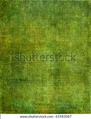A vintage green background with a grunge screen pattern. - stock photo