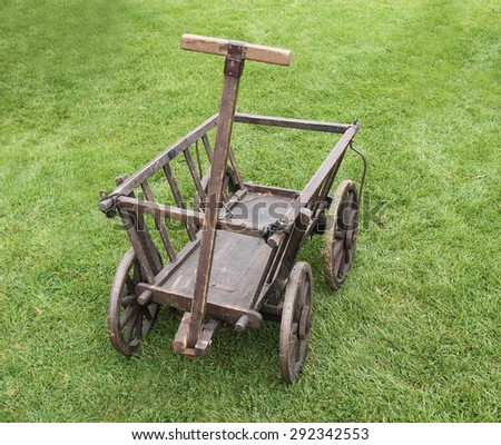 A Vintage Hand Drawn Small Wooden Cart. - stock photo