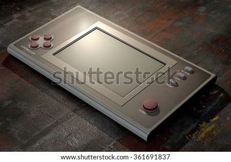 A vintage handheld video game console with a blank screen on a dark background - stock photo
