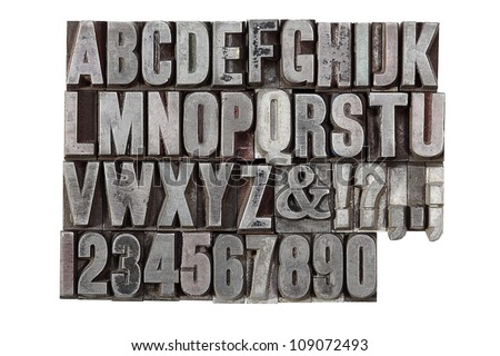 A vintage letterpress alphabet isolated on a white background - stock photo