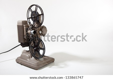 A vintage 8mm movie projector on a white background with copy space - stock photo