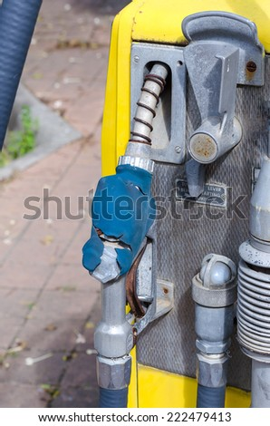 A vintage rusted gas pump abandoned - stock photo