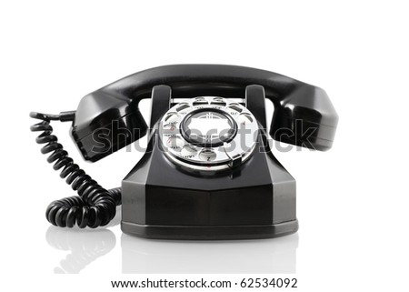 A vintage 1940-s Automatic Electric rotary telephone isolated on white - stock photo