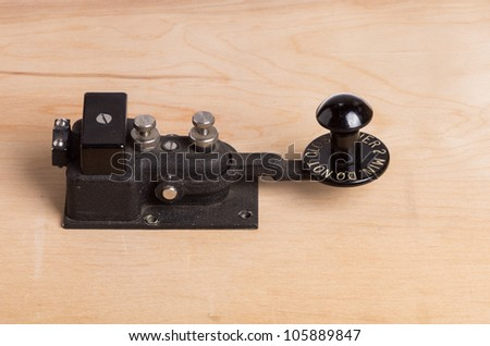 A vintage telegraph key sitting on a desk - stock photo