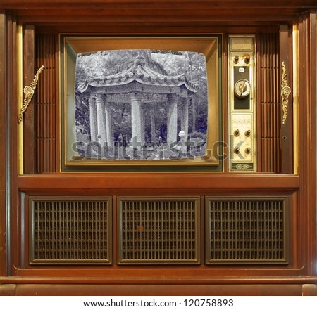 A vintage television set from about sixty years ago with a grainy pic - stock photo