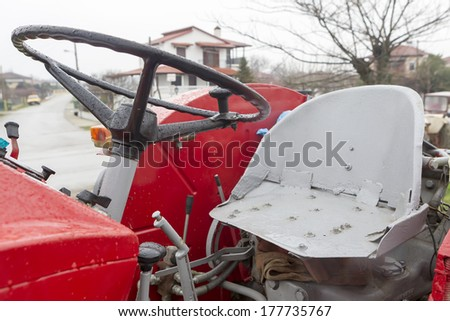 A vintage tractor steering wheel - stock photo