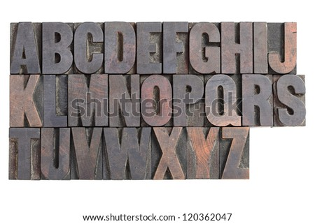 A vintage wood letterpress alphabet isolated on a white background - stock photo