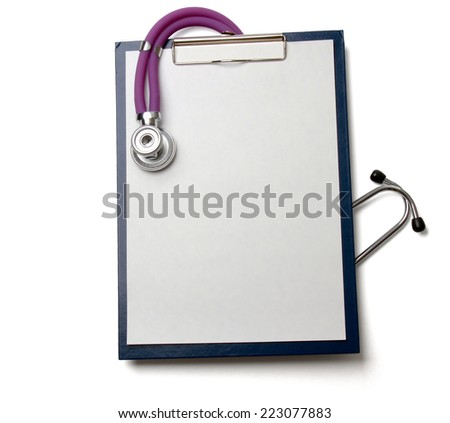 A violet stethoscope lying near white laptop computer - stock photo