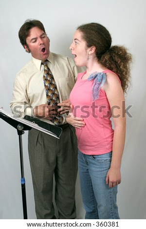 A voice coach and student breathing from the diaphragm.. - stock photo