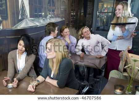 a waitress laughing with her customers - stock photo