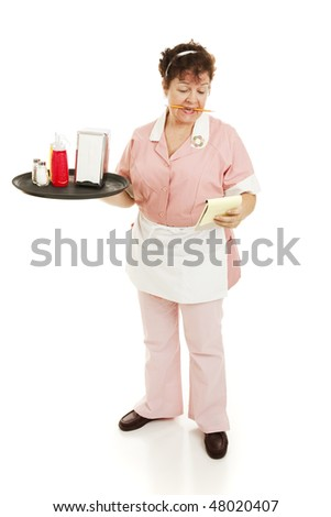 A waitress starting her shift, reading notes on her pad.  Full body isolated. - stock photo