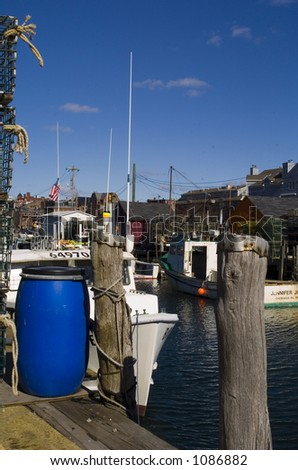 A walk along the oceanfront streets in Portland, Maine yields beautiful pictures of lobster traps, ropes, lobster boats, colorful buoys a breathtaking landscapes. - stock photo