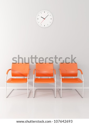A wall clock and 3 orange chairs in the waiting room - stock photo