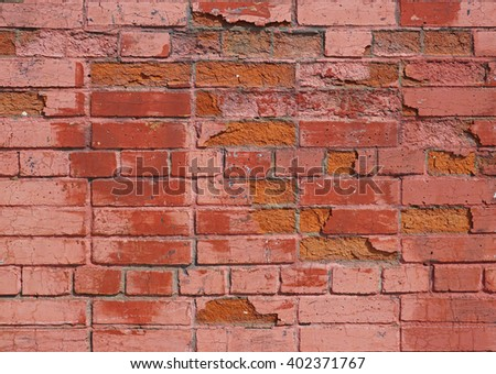 A wall of old red brick painted - stock photo