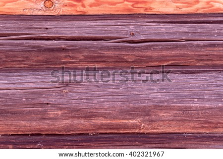a wall of wood, timber, uneven red wooden surface - stock photo