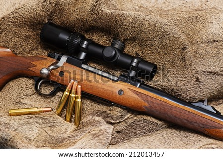 A walnut stocked big-bore hunting rifle intended for use on dangerous game.  - stock photo