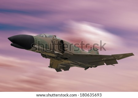A war jet is flying on a red sky - stock photo